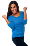 Excited pretty girl with clenched fists Stock Photos