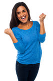Excited pretty girl with clenched fists Stock Photo