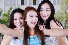 Excited pretty girls taking a selfie Stock Photography