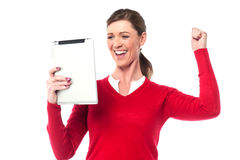 Excited pretty woman holding touch pad Royalty Free Stock Photo