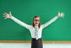 Excited pupil happy smile with her raised hands arms palms Royalty Free Stock Image