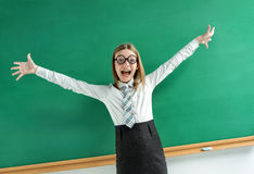 Excited pupil happy smile with her raised hands arms palms. Stock Images