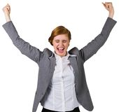 Excited redhead businesswoman cheering Royalty Free Stock Images