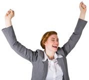 Excited redhead businesswoman cheering Royalty Free Stock Photos