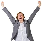 Excited redhead businesswoman cheering Royalty Free Stock Photography