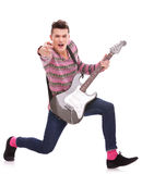 Excited rock star pointing to the camera Stock Image