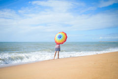 Excited romantic female having fun on beach walk on sunny outdoors background stock images