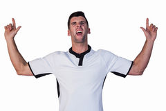Excited rugby player pointing up Stock Images