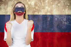Excited russia fan in face paint cheering Stock Images