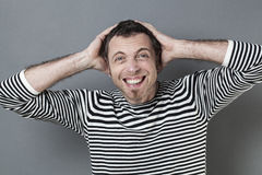 Excited 40s man frowning for fun disillusion Stock Photography