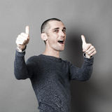 Excited 30s man with thumbs up for success Stock Images