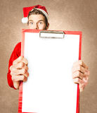 Excited santa displaying copyspace clip board Stock Images