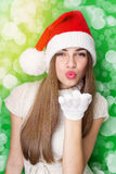 Excited Santa girl blowing kisses Stock Photo