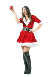 Excited Santa girl holding sphere red candle looking away with open mouth Stock Photography