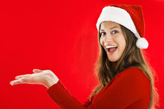 Excited Santa Girl Showing Royalty Free Stock Image