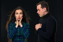 Excited scared nervous woman look into camera, man stand by side, have eyes full in disbelief. On black background. Excited scared nervous women look into camera royalty free stock photo