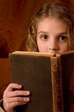 Excited school girl. Girl reading a book for school surprise Royalty Free Stock Images