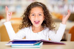 Excited school girl Stock Images