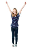 Excited school girl with raised arms Royalty Free Stock Photos