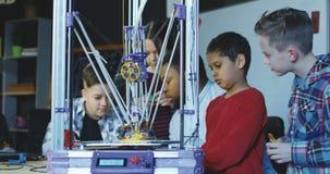 Teacher with kids exploring 3d printing stock footage