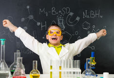 Excited schoolboy in chemistry lab made a discovery Royalty Free Stock Photo