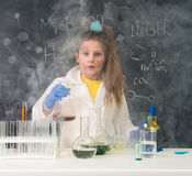 Excited schoolgirl in fume after chemical experiment. In scool lab Royalty Free Stock Images