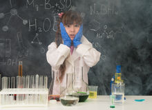 Excited schoolgirl in fume after chemical experiment. In scool lab Stock Photos