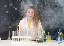 Excited schoolgirl in fume after chemical experiment. In scool lab Stock Photo
