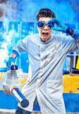 Excited scientist with wind machine Royalty Free Stock Photography