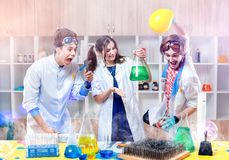 Excited scientists in lab. Group of excited young scientists making experiment in modern laboratory Stock Photography