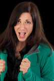 Excited screaming woman. Shouting woman with open mouth and piercing. Studio shot against a black background Royalty Free Stock Photos