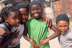 Excited Senegalese Girls on Tabaski Holiday. Four Senegalese girls in Dakar smile excitedly, happy that the long-awaited Tabaski holiday (Muslim festival of Eid Royalty Free Stock Photos