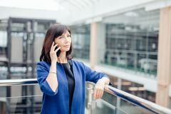 Excited Senior Business Lady Talking on Phone. Excited Senior Business Lady Talking on smart Phone Stock Photo