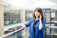 Excited Senior Business Lady Talking on Phone. Excited Senior Business Lady Talking on smart Phone Stock Image