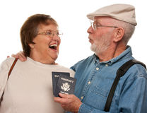 Excited Senior Couple with Passports and Bags on White Royalty Free Stock Photo