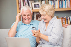 Excited senior couple using laptop Stock Images