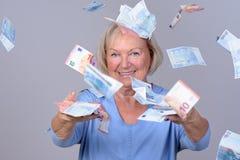Excited senior lady celebrating a windfall Stock Image