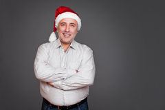 Excited senior man in santa claus hat Stock Photos
