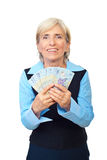 Excited senior showing Romanian money Royalty Free Stock Photo
