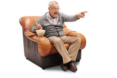 Excited senior watching TV Stock Images