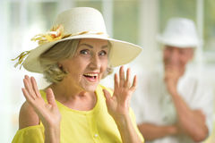 Excited senior woman in hat Stock Photo