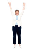 Excited senior woman posing with raised arms Royalty Free Stock Image