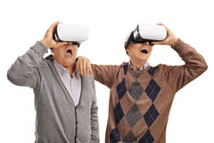 Excited seniors using VR headsets Stock Image