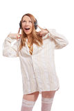 Excited sexy blond girl in headphones laughing Stock Images
