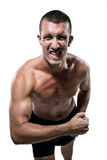 Excited shirtless athlete flexing muscles Stock Photo