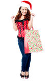 Excited shopaholic woman in trendy attire Stock Images