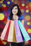 Excited shopper holds christmas shopping bags Royalty Free Stock Photo