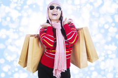 Excited shopper in winter season Stock Photos