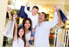 Excited family shopping Royalty Free Stock Photo