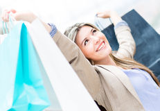 Excited shopping woman Stock Photo